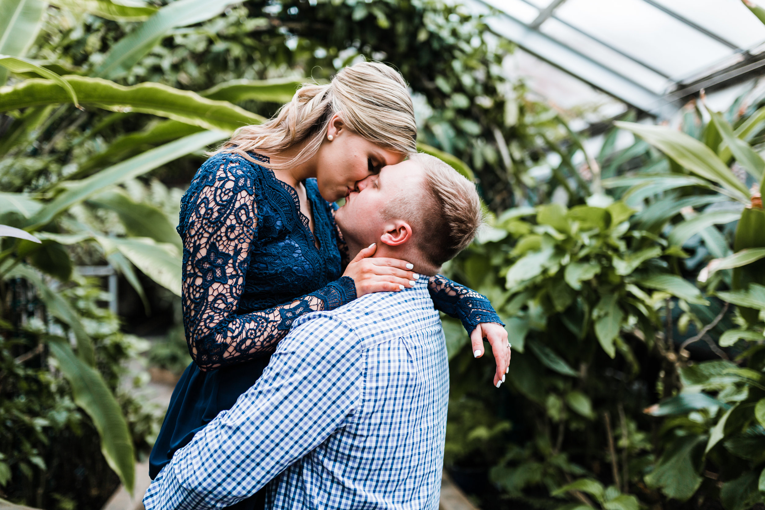 engagement session with beautiful greenery at conservatory in Baltimore MD - best rated husband and wife photography team in Maryland