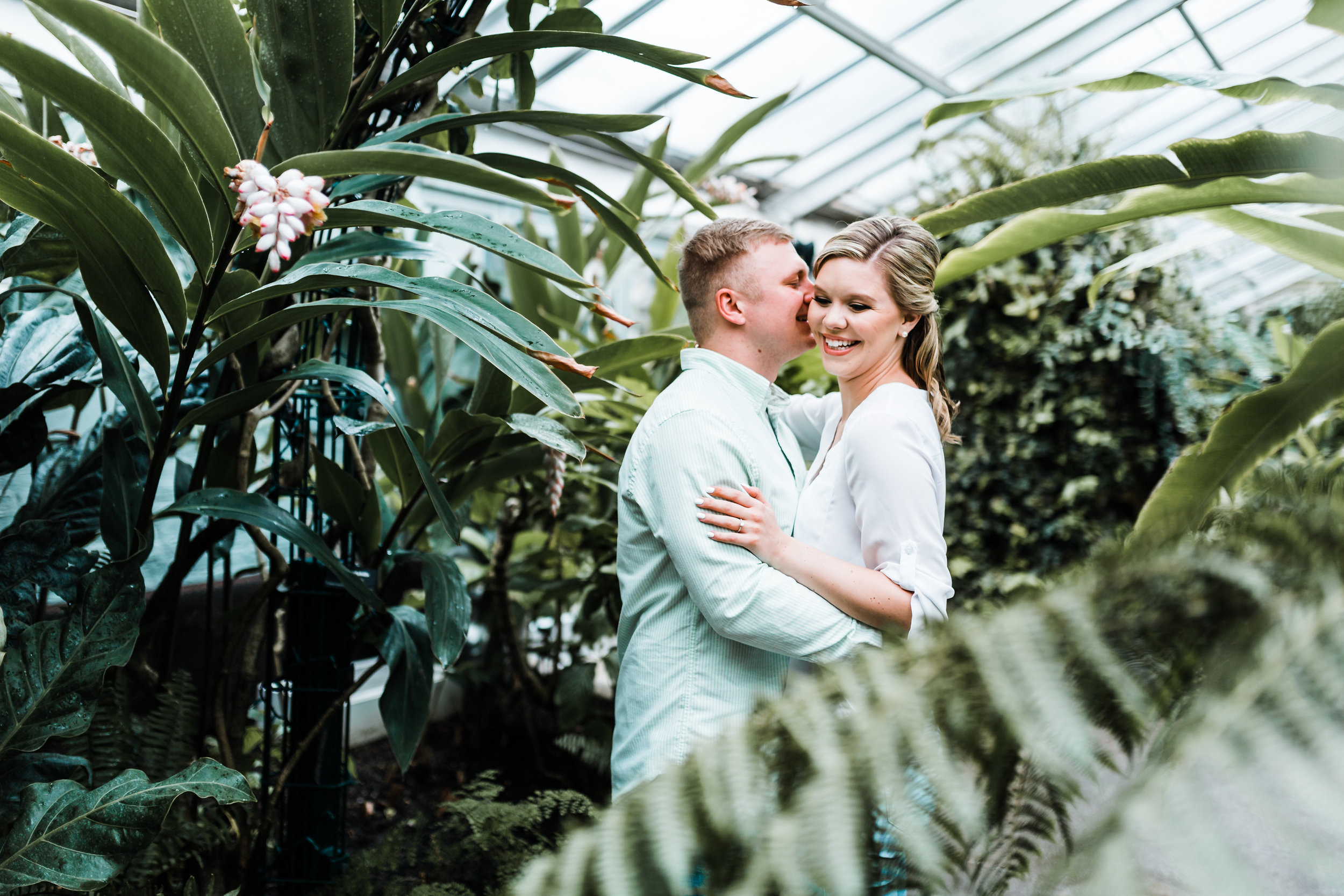 beautiful palms and flowers at conservatory engagement session - best romantic portrait photographer in Maryland