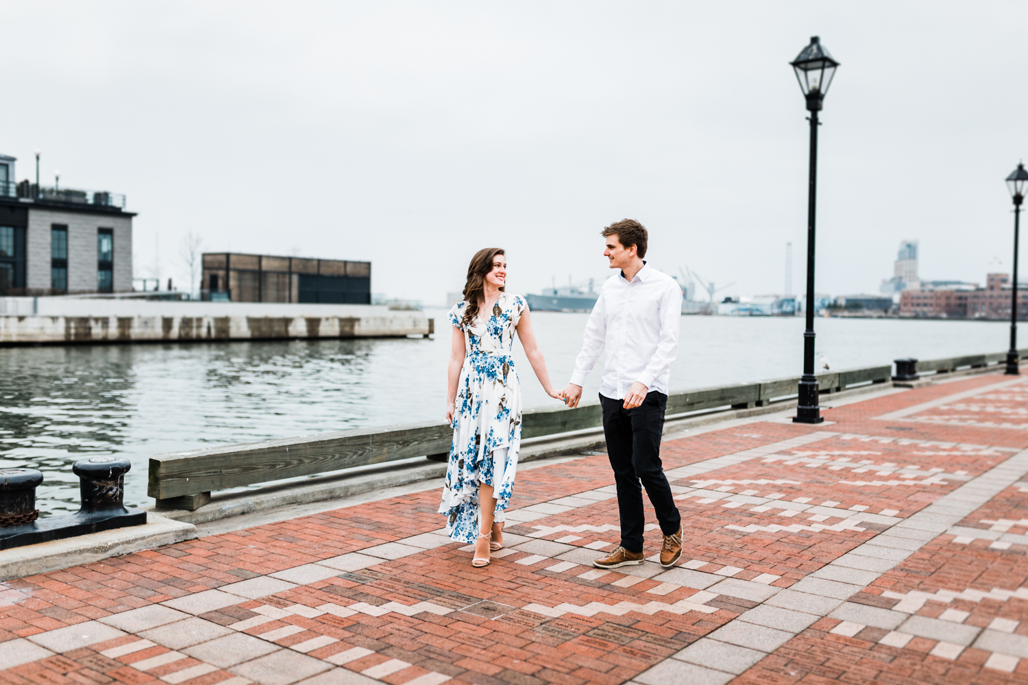 couple walking together during Fells Point engagement session