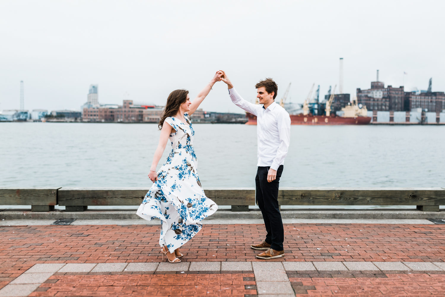 Couple dancing at Fells Point - best locations in Baltimore for engagement photos