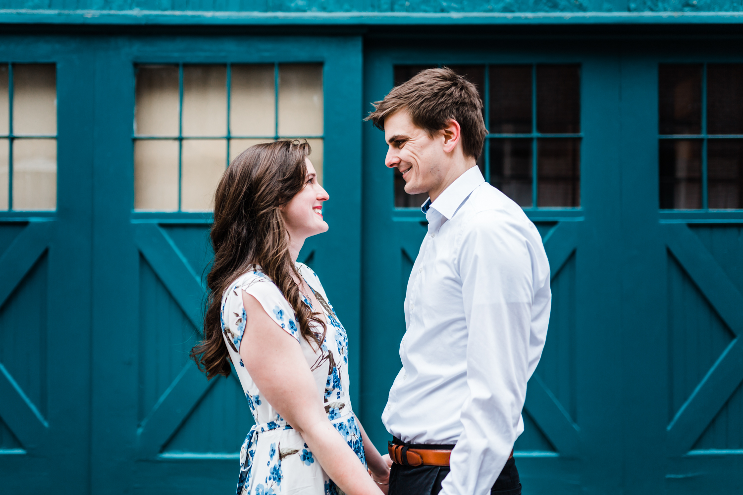 couple smiling at each other during their Baltimore engagement session