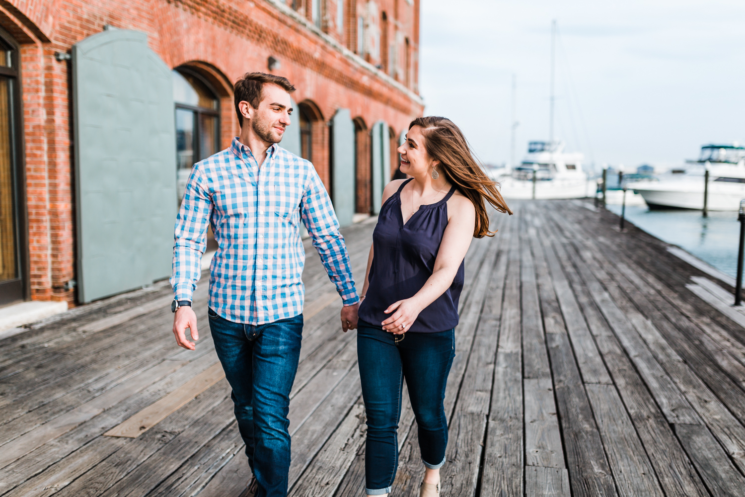 couple walking and holding hands during their Baltimore engagement session