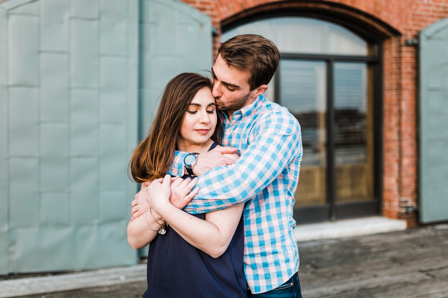 groom kisses his bride on her head during their Baltimore Maryland engagement photos