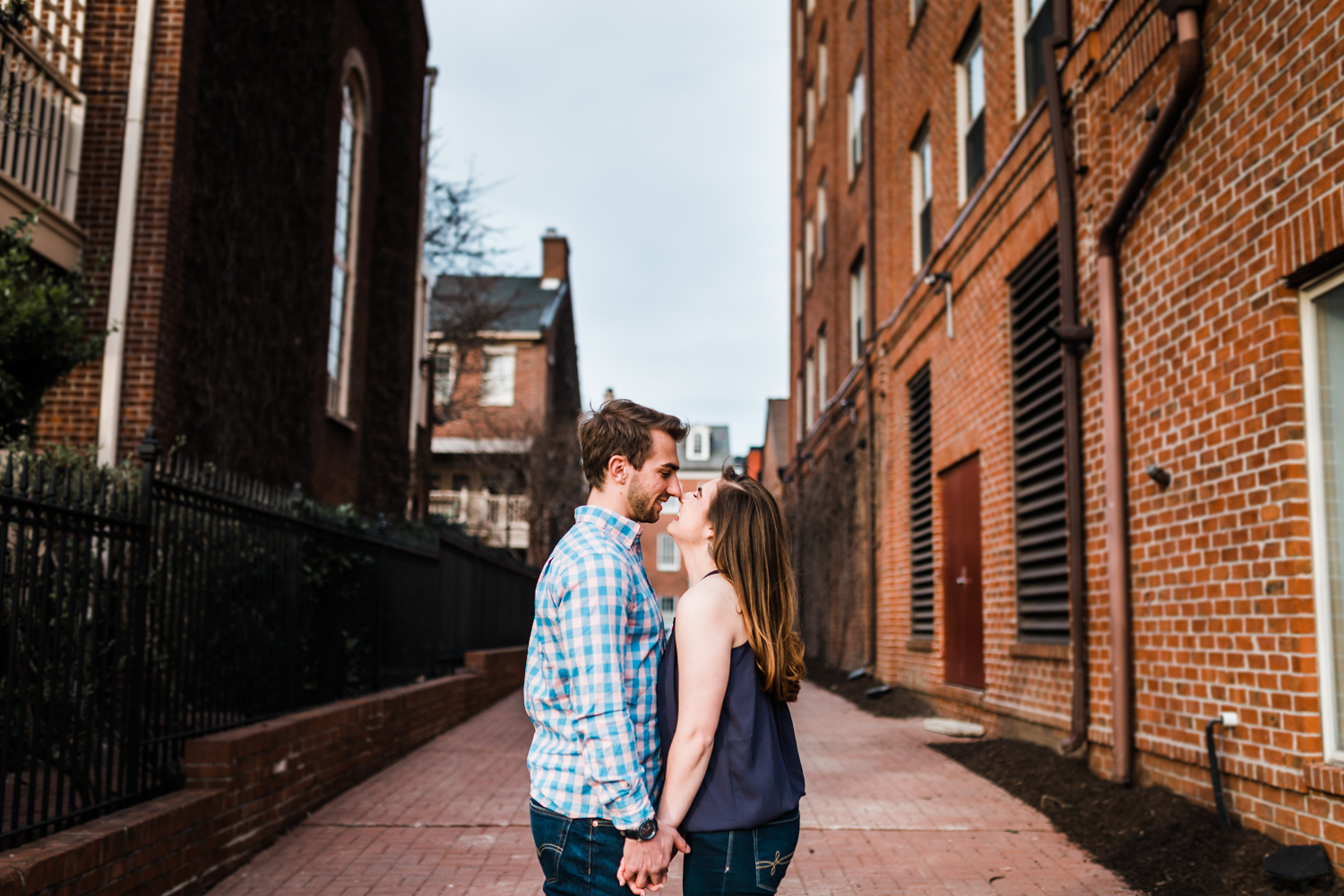 couple laughing in alleyway in Fells Point