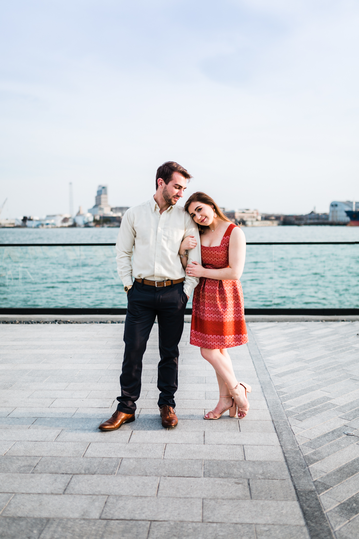 couple poses by the pool of the Sagamore Pendry in Baltimore, MD - high end wedding photography in Baltimore, Maryland