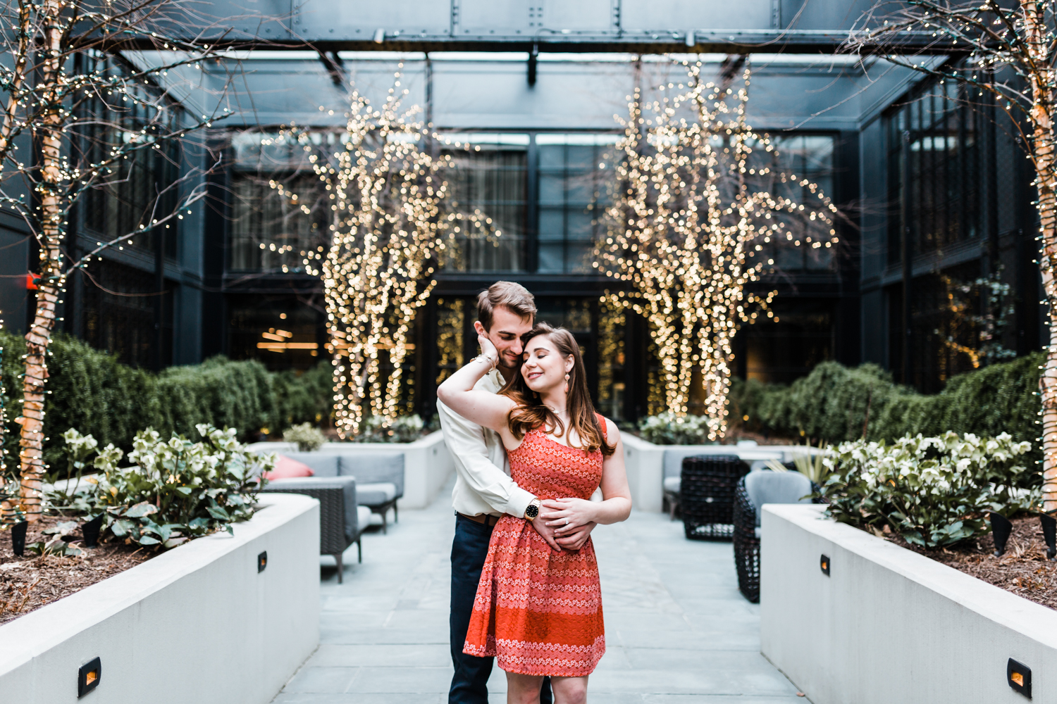 couple poses inside the Sagamore pendry during their engagement session