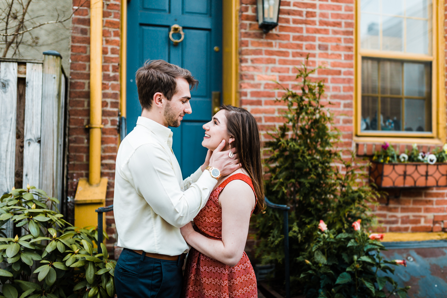 adorable couple on a side street in Fells Point during their engagement photos