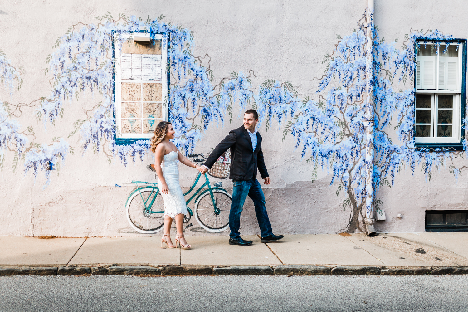 couple walking together in downtown annapolis maryland for their engagement session