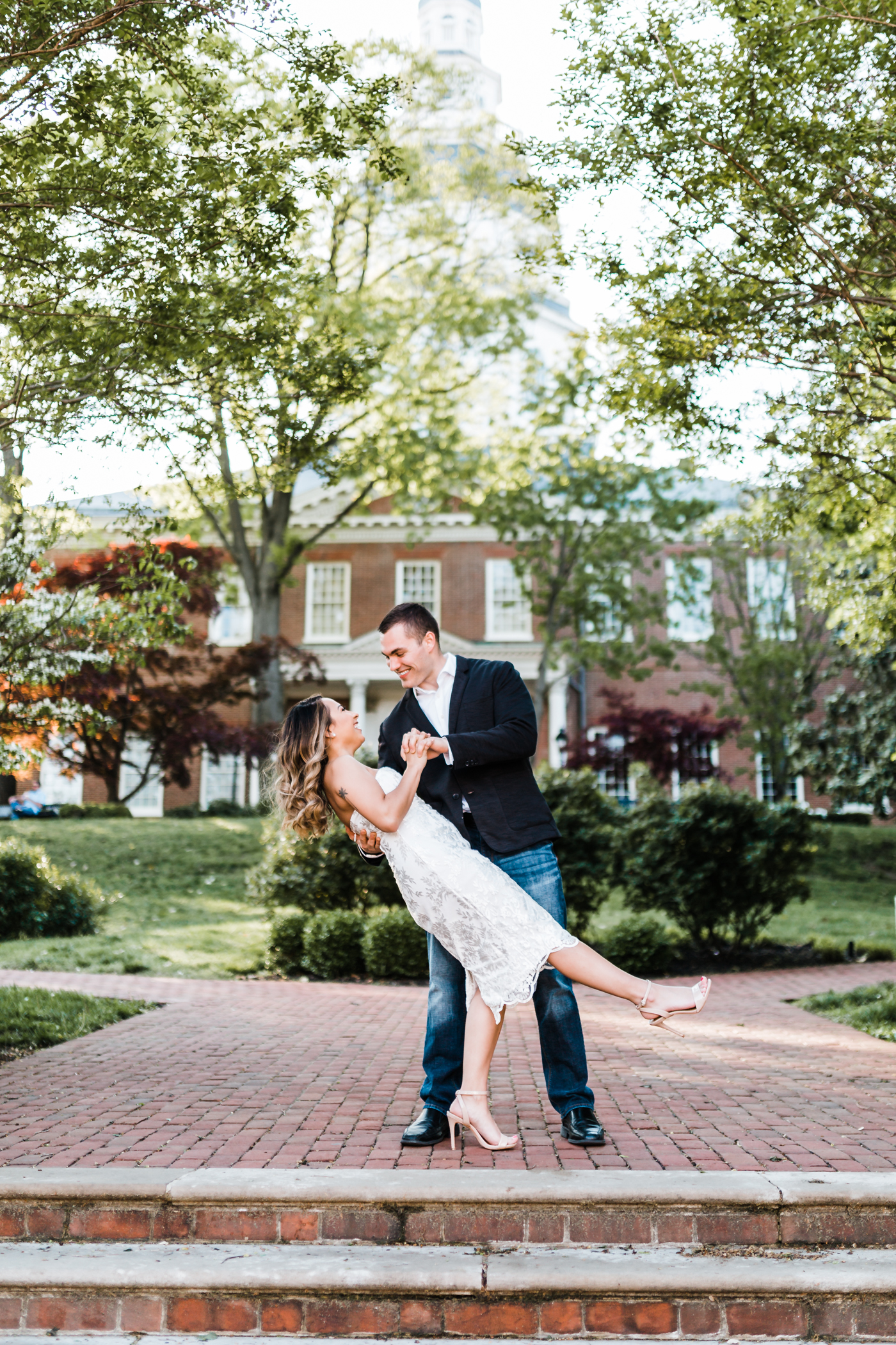 bride and groom practice their dip in front of the Annapolis state house - top rated wedding photographer in Annapolis, Maryland
