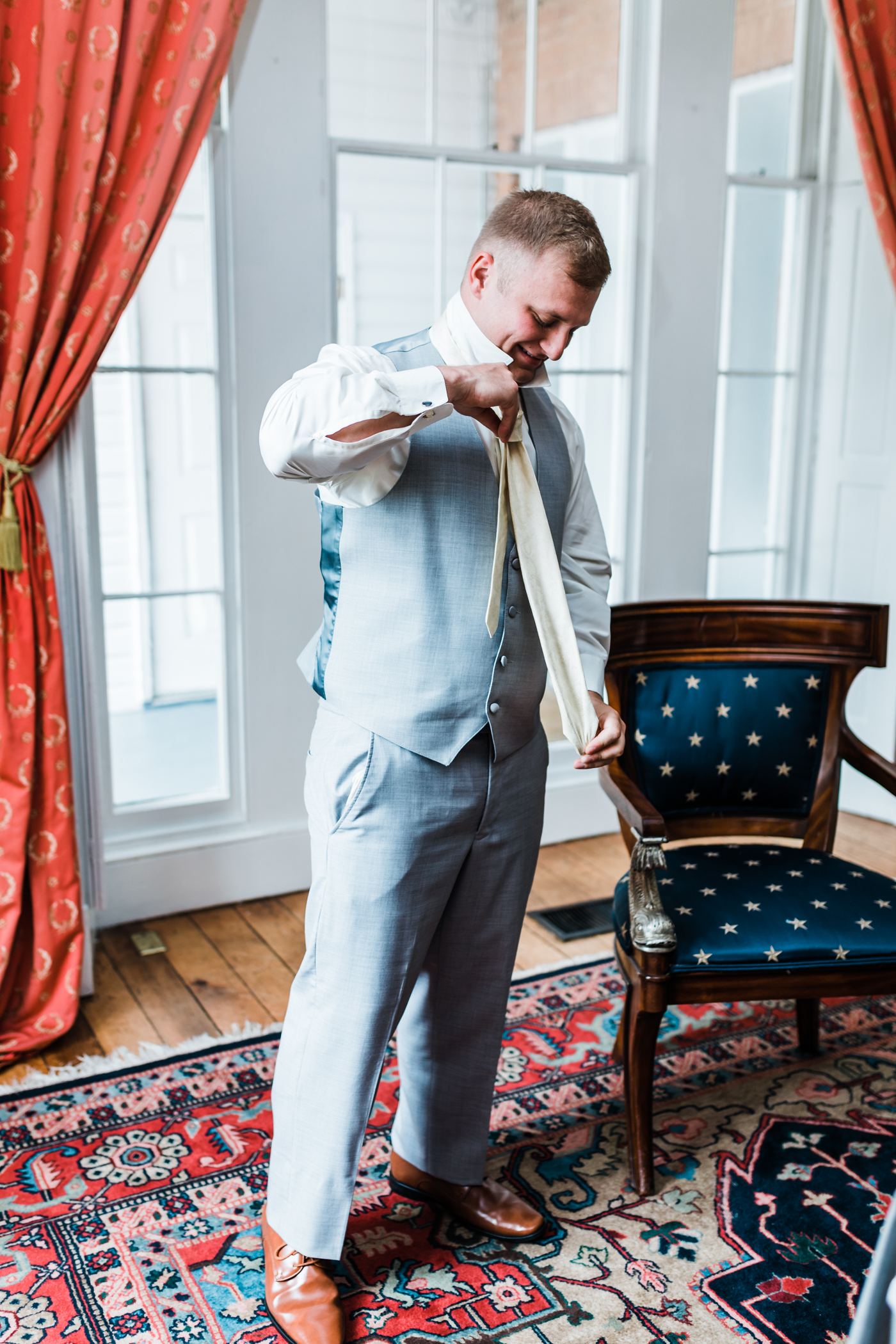 groom getting dressed - highly rated photographer in Maryland
