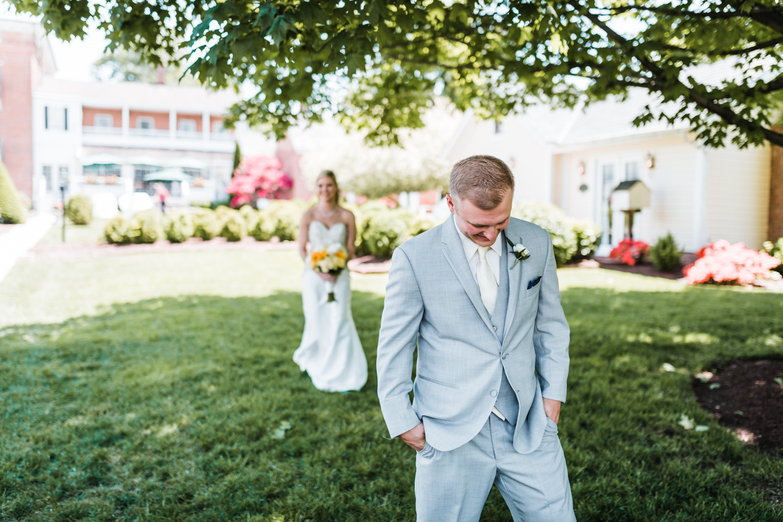 groom waiting to see bride in first look - elegant wedding venues in Maryland Antrim 1844