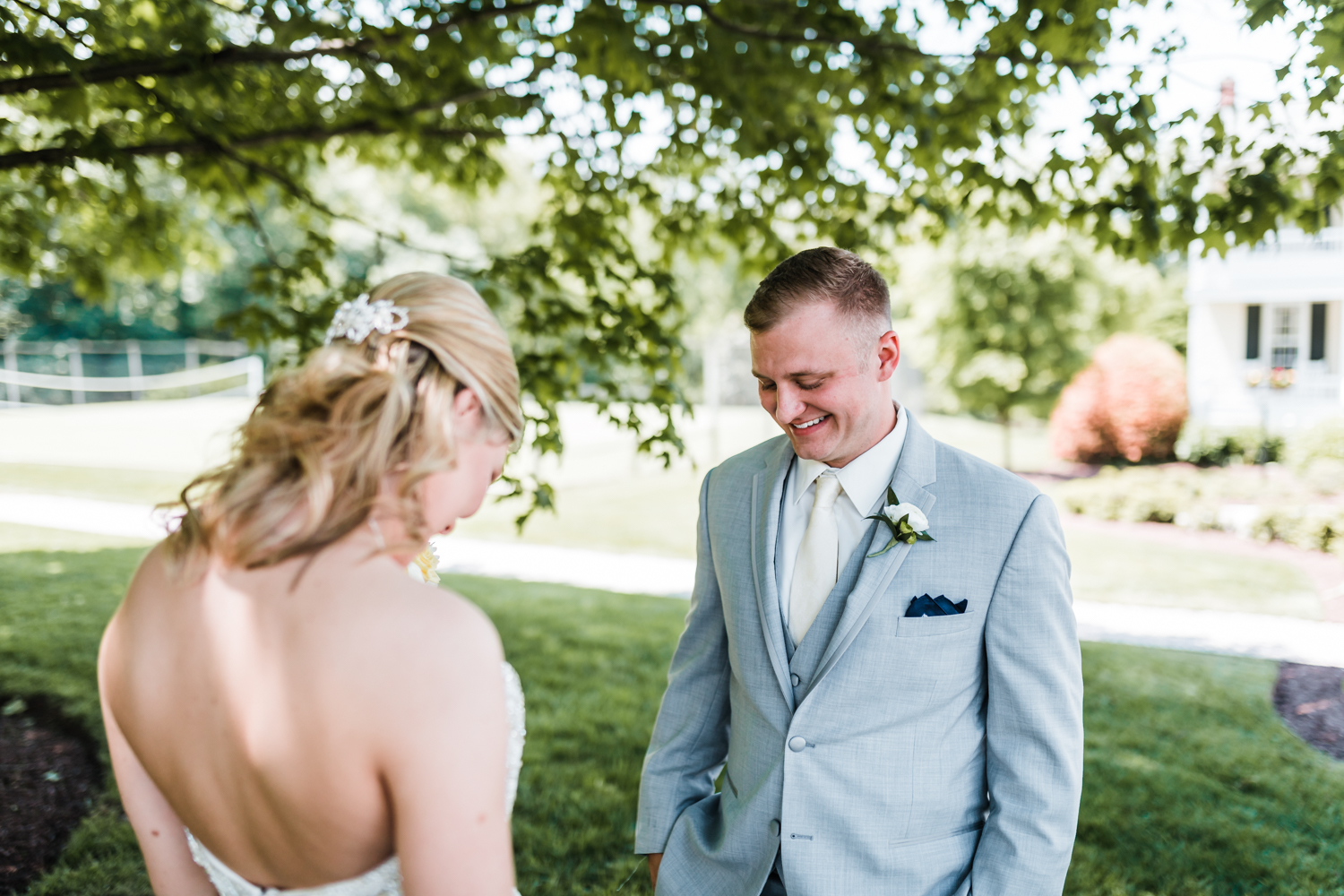 groom reacts to bride in first look - best husband and wife photography team in Carroll County Maryland