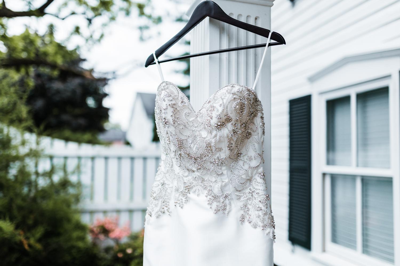 wedding dress hanging up outside - historic elegant venue in Maryland Antrim 1844