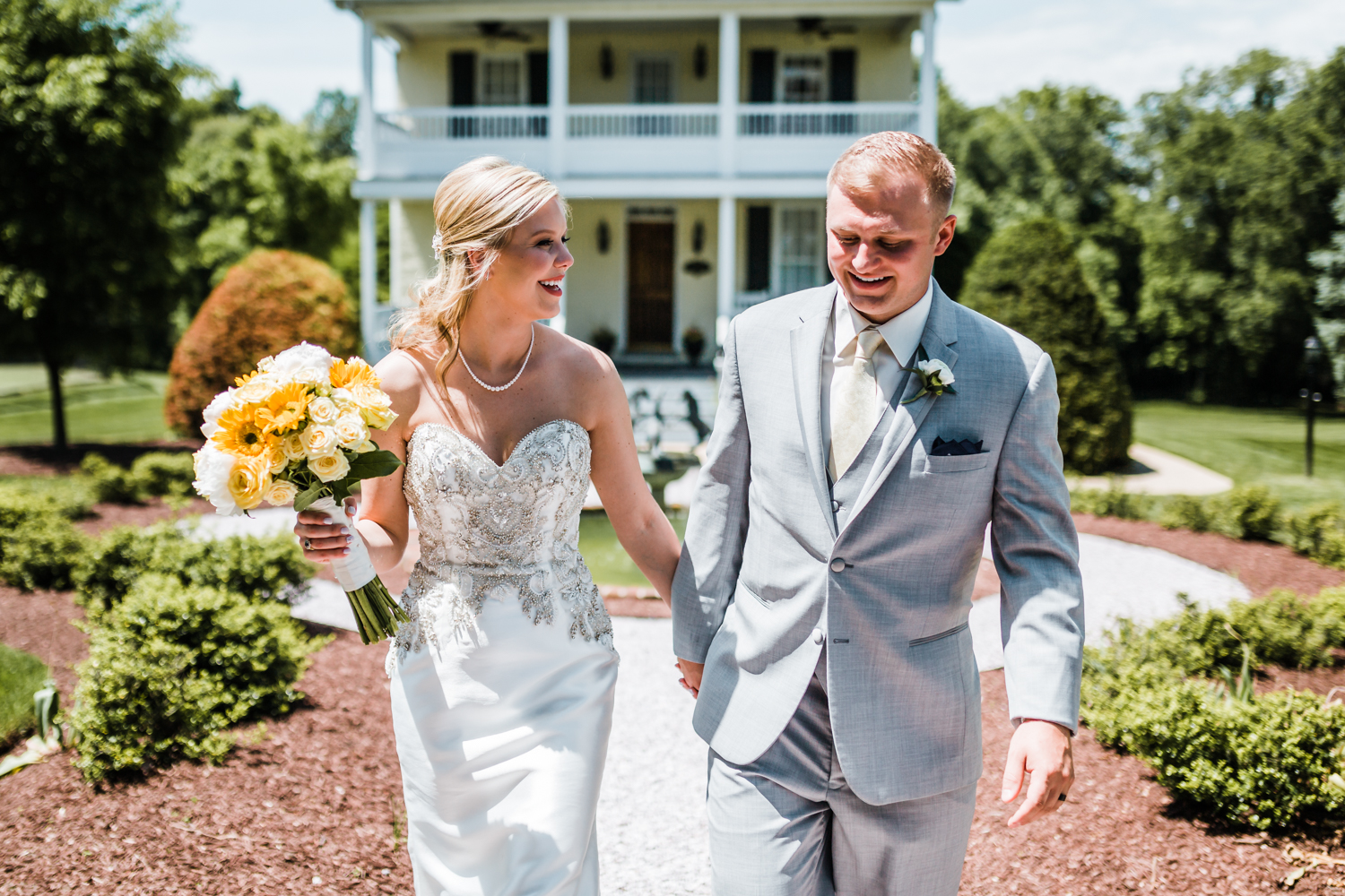 newlyweds holding hands - best photographer in Maryland