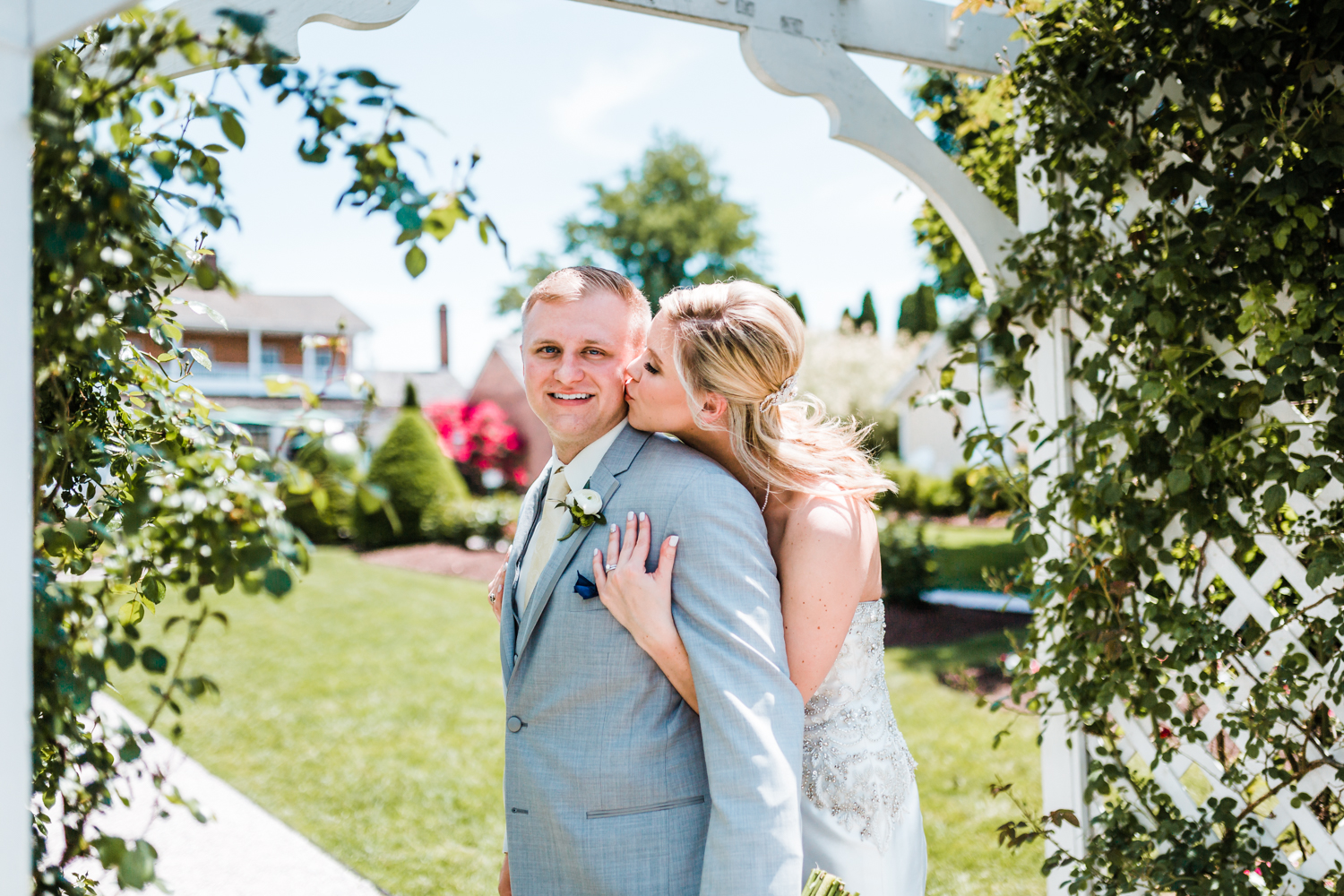 bride kissing groom at historic venue in Carroll County Maryland - top rated photography in MD