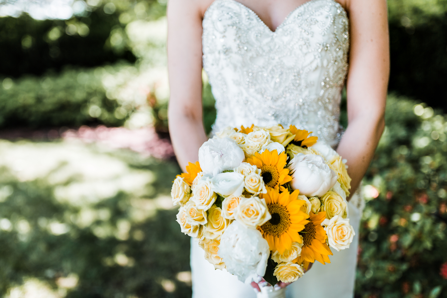 sunflower and peony bouquet - best husband and wife photography team in Maryland