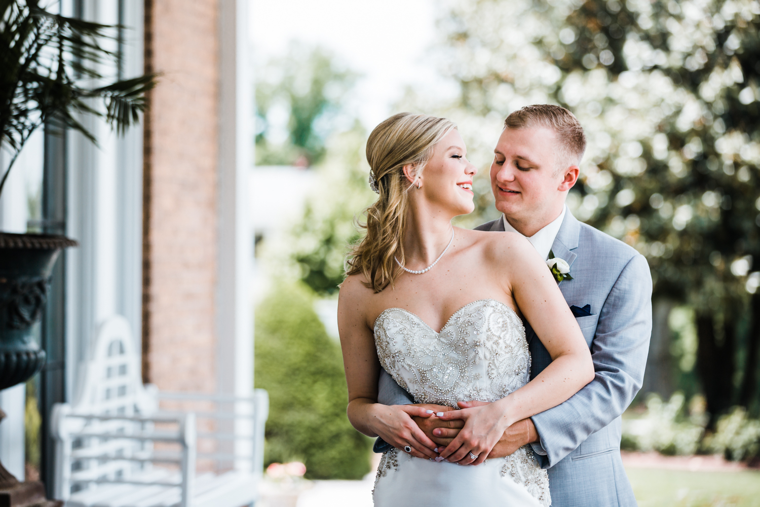 loving bride and groom wedding - top rated husband and wife photographers in Maryland