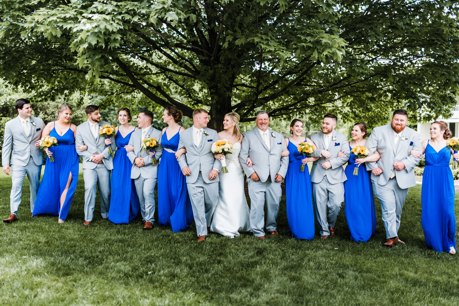 bridal party walking with bride and groom at Antrim 1844 - top rated photographer in MD