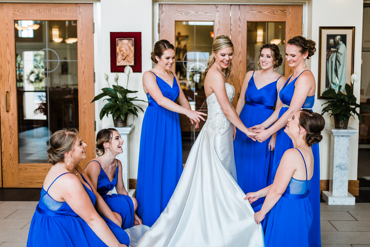 bride and her bridesmaids getting ready at St. Johns Catholic church in Westminster, MD