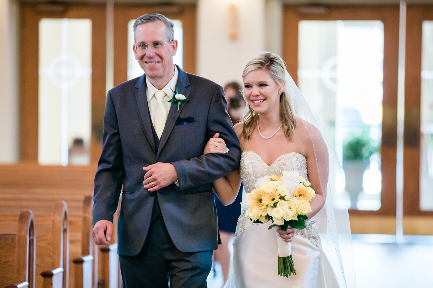 bride walking down the aisle with her father - carroll county maryland wedding photographer