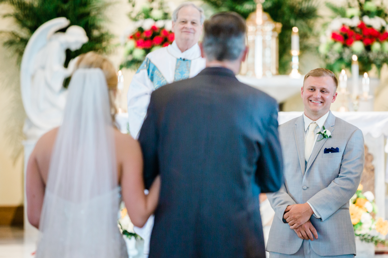 grooms reaction to his bride coming down the aisle for the first time - best wedding photographer in Maryland