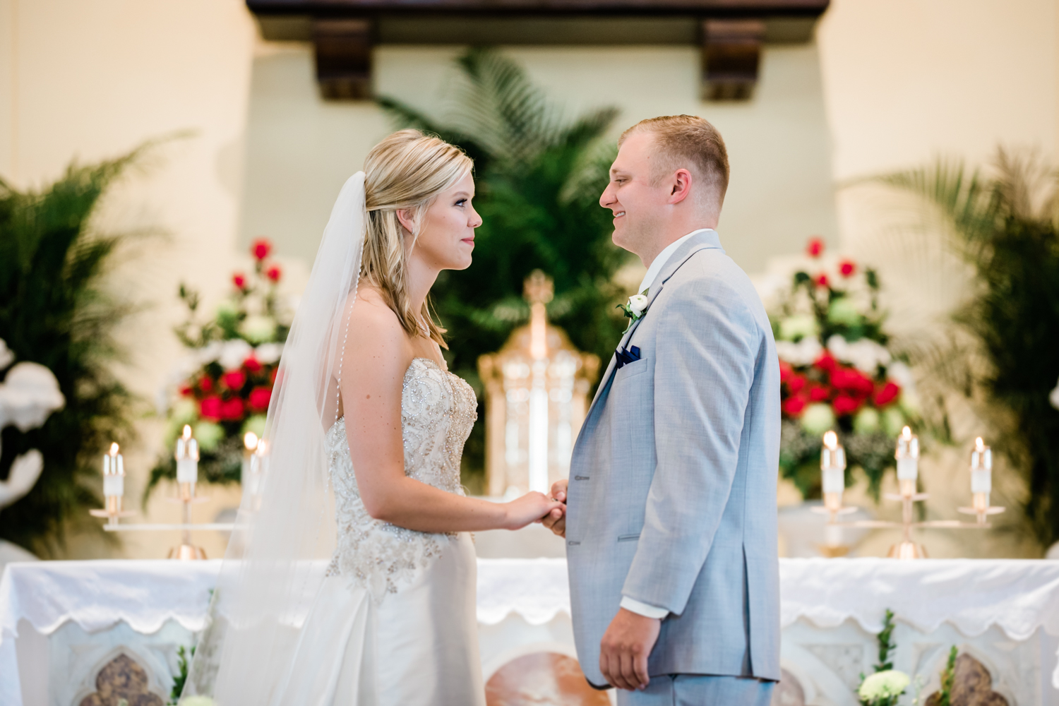 bride and groom stand at the altar together in Westminster, MD - highly recommended wedding photographer near Carroll County, MD