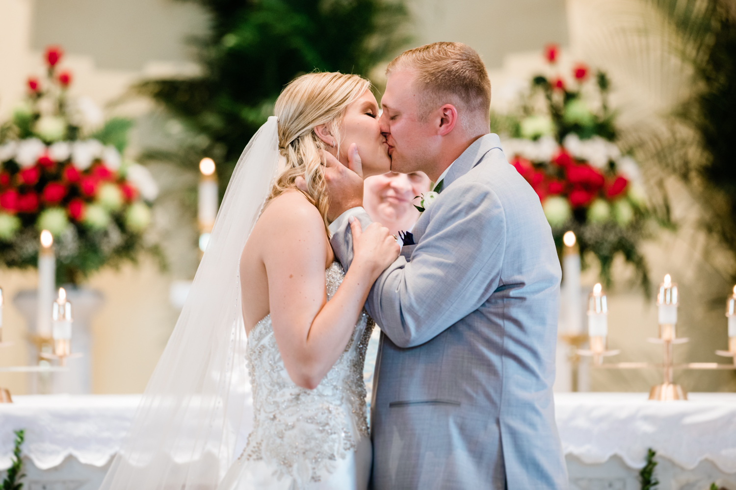 bride and groom share their first kiss at wedding ceremony in Westminster, Maryland