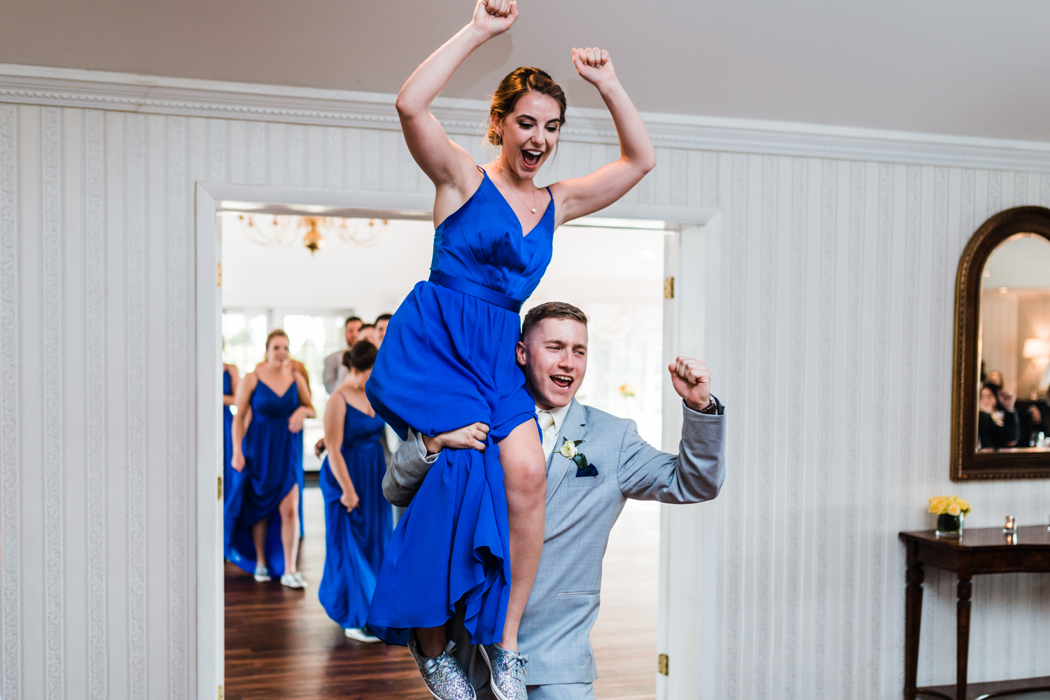 gray groomsman suit and bridesmaid blue dress