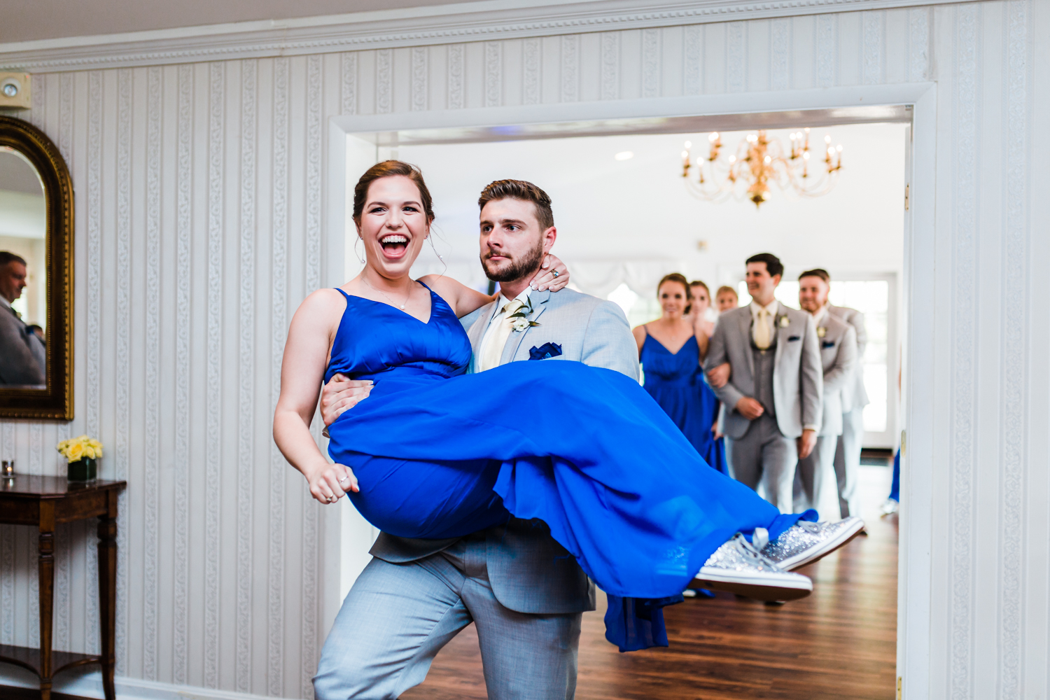 bridesmaid and grooms man being introduced to reception - top candid photographer in Maryland