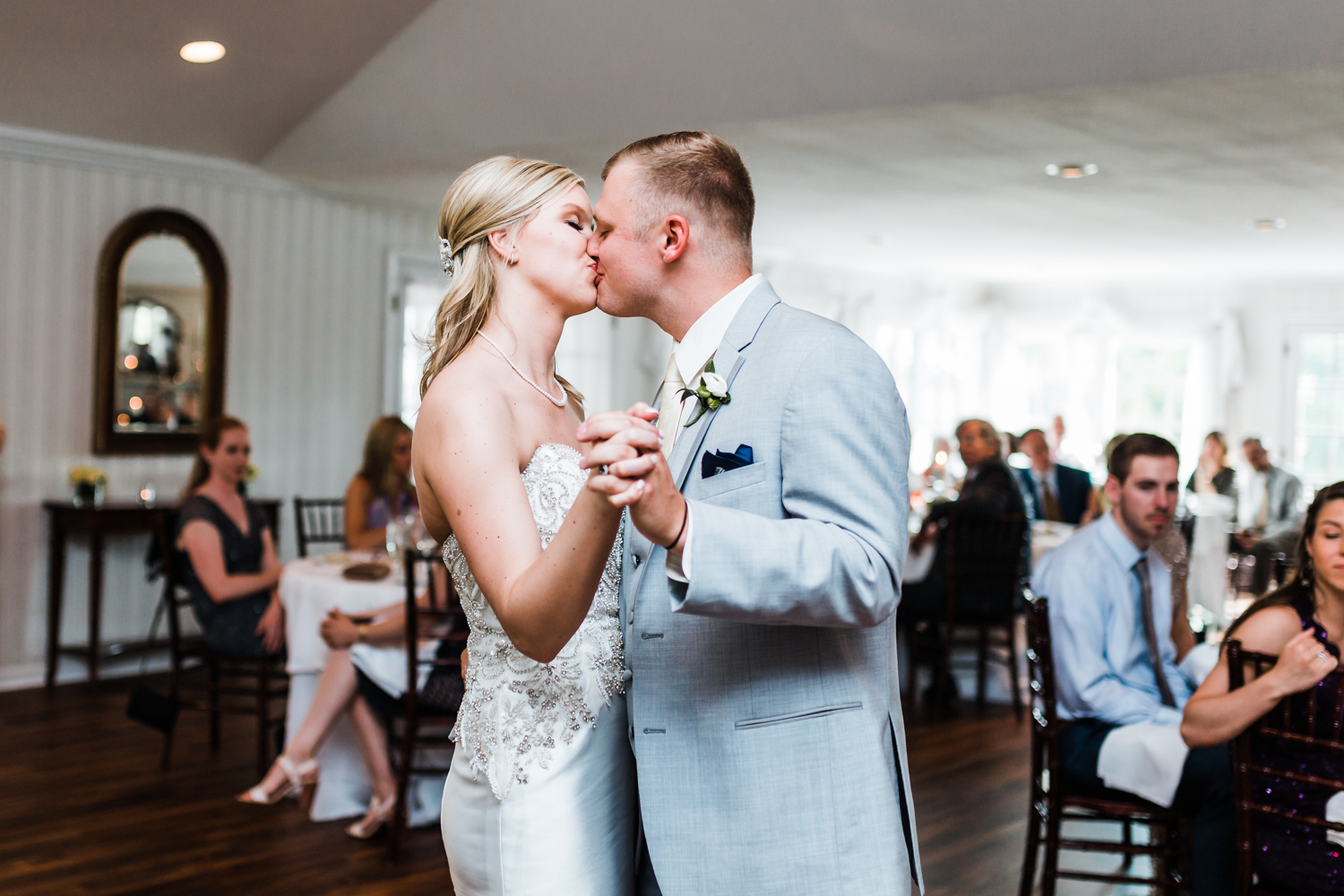 bride and groom share their first dance and kiss at Antrim 1844 - best garden wedding venues in maryland