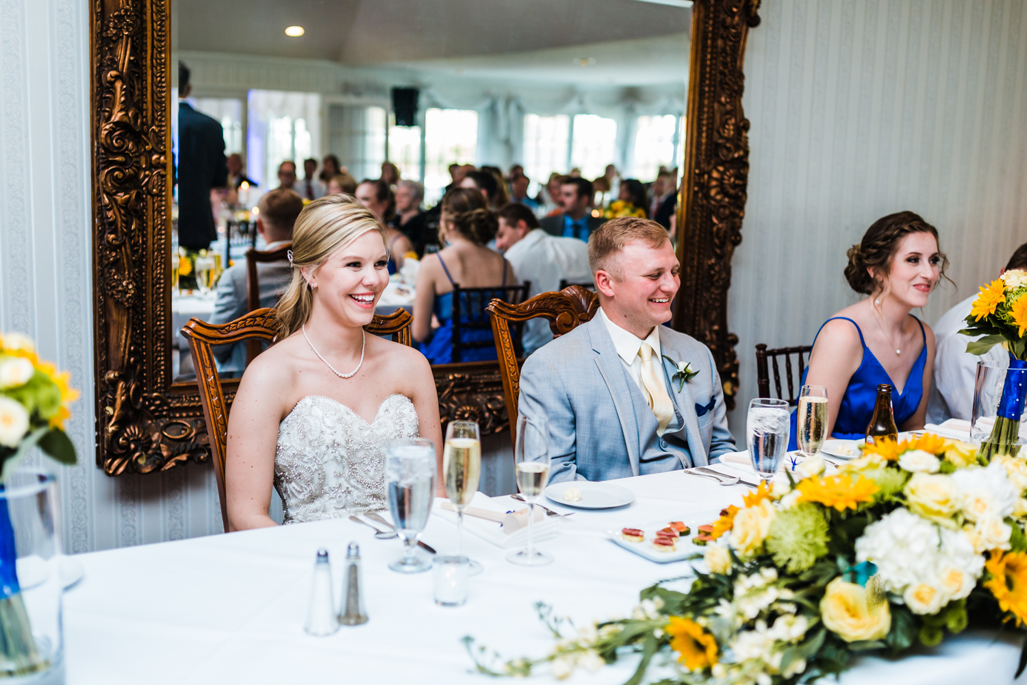 bride and groom lauging while father of bride gives a welcome speech and toast - carroll county md wedding photographer