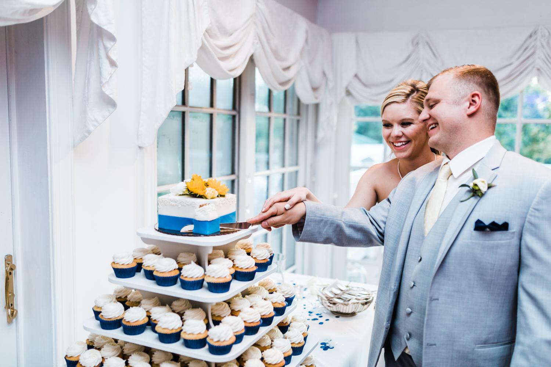 bride and groom cut their cake at Antrim 1844 wedding reception