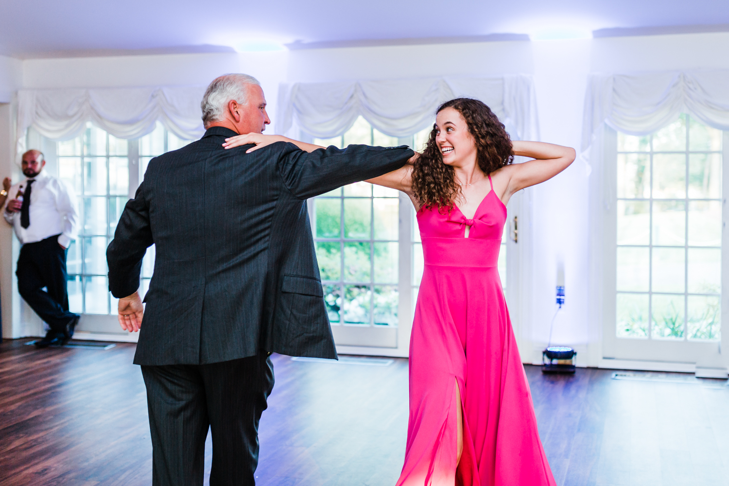fun reception dancing photos - best rated wedding photography husband and wife team in Maryland