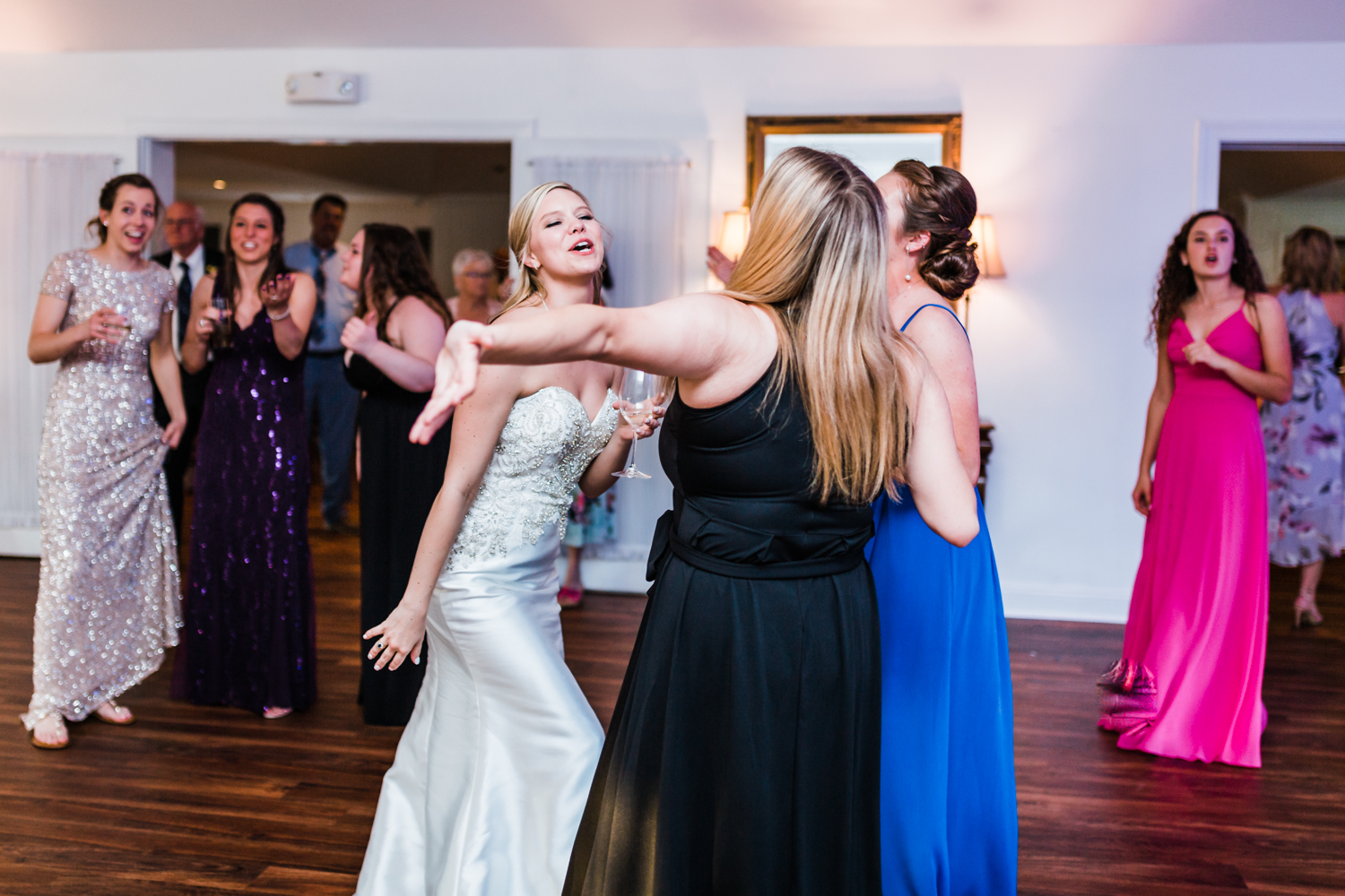 bride dancing and singing with her friends at her wedding reception at Antrim 1844 in Taneytown