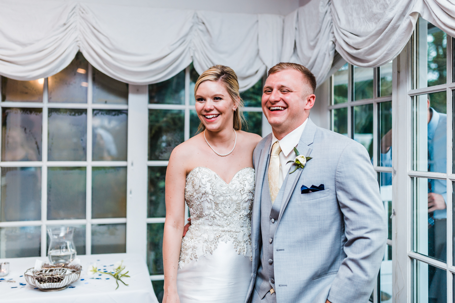 bride and groom laughing while their guests dance - best wedding photography in carroll county maryland