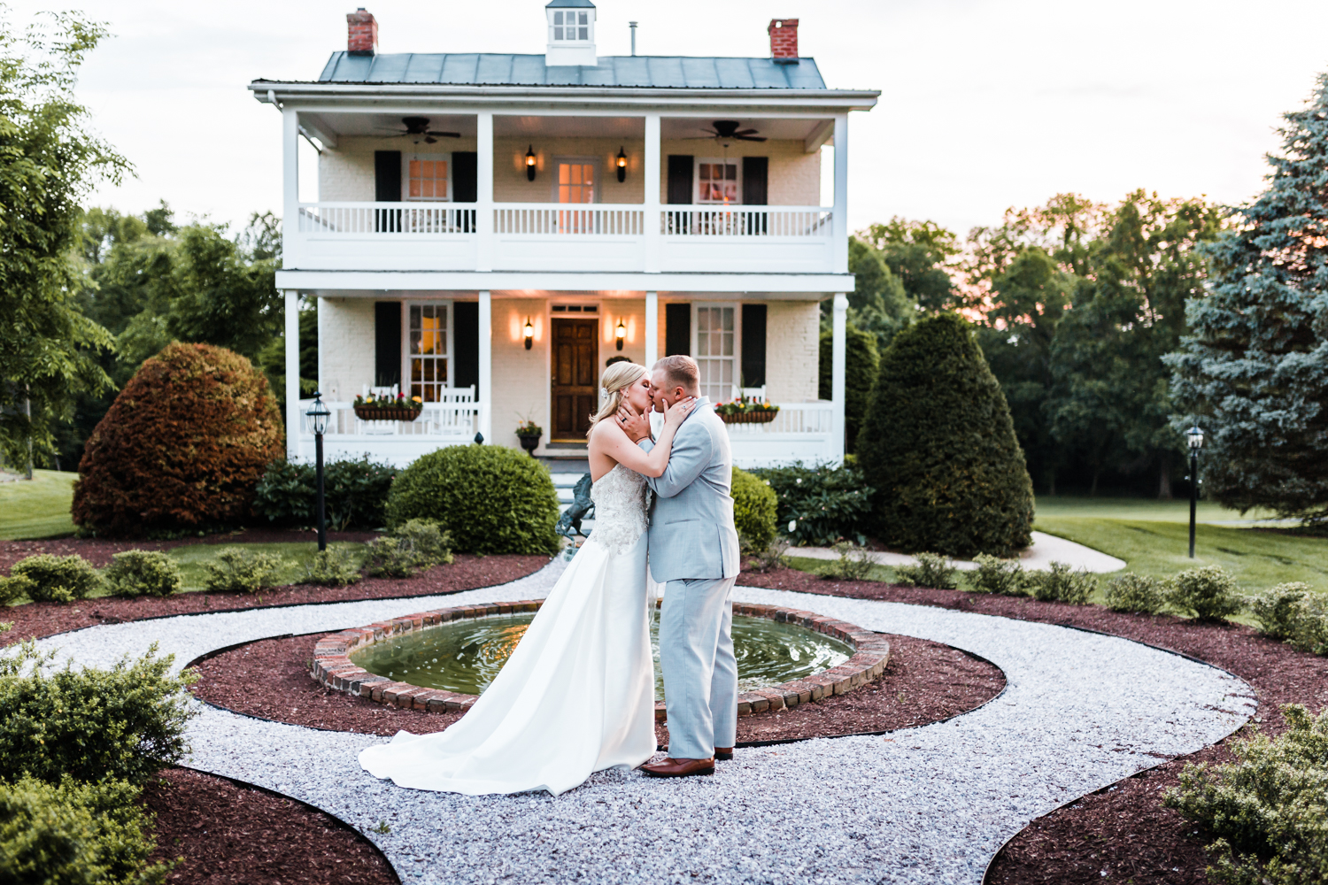 bride and groom kiss outside of Antrim 1844 - top maryland wedding photo and film team