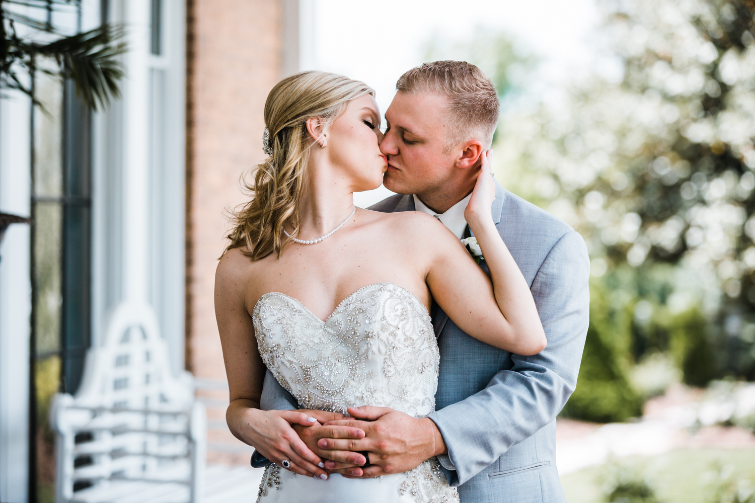 sweet couple sharing kiss at historic wedding venue in Carroll County MD