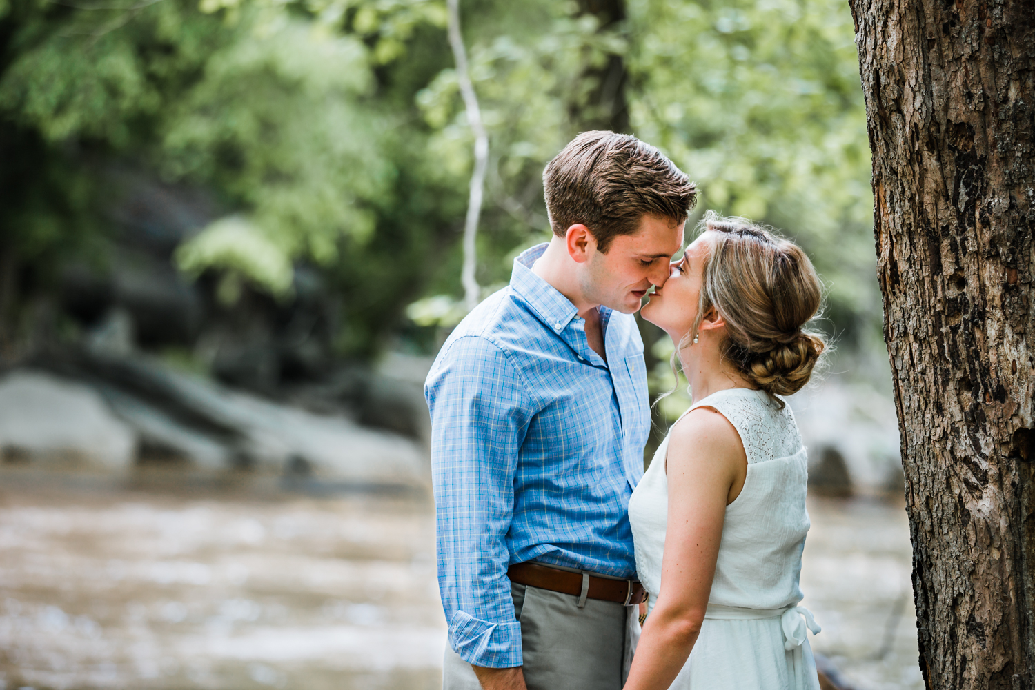 couple kissing during their engagement session in Historic Ellicott City, Maryland
