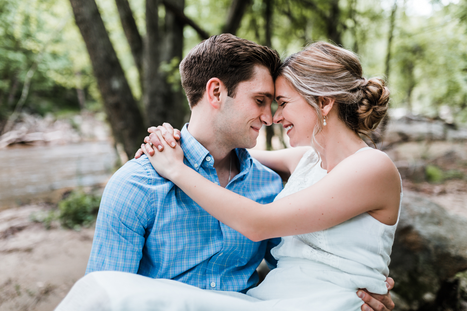 couple snuggles during their engagement session - best wedding and engagement photographer in Maryland