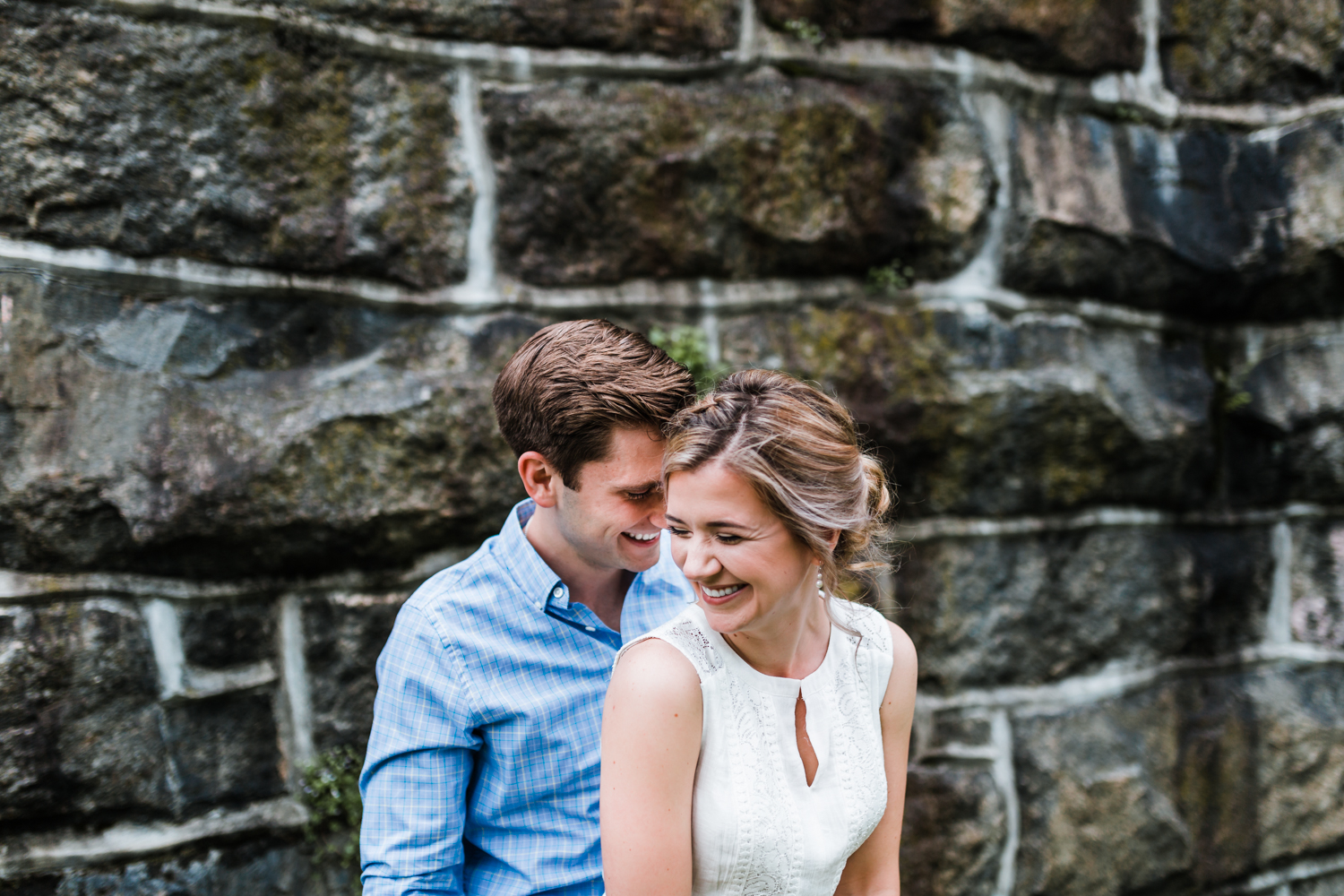 bride and groom laughing together at their engagement session in Ellicott City, MD