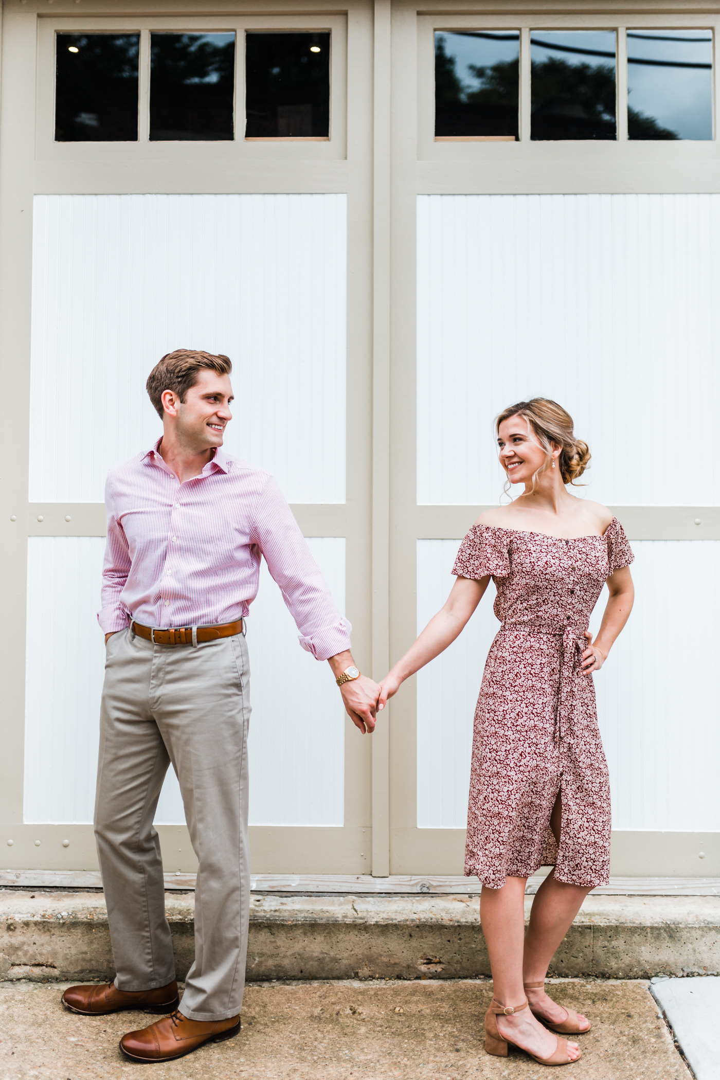 classy couple in front of doors in historic ellicott city maryland