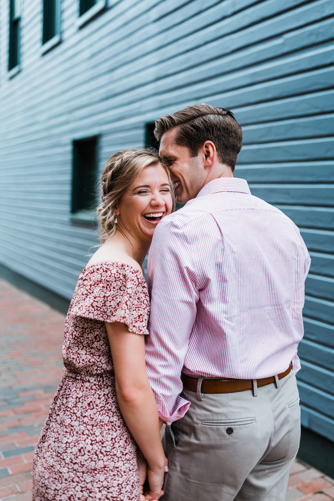 couple laughing together in historic ellicott city maryland