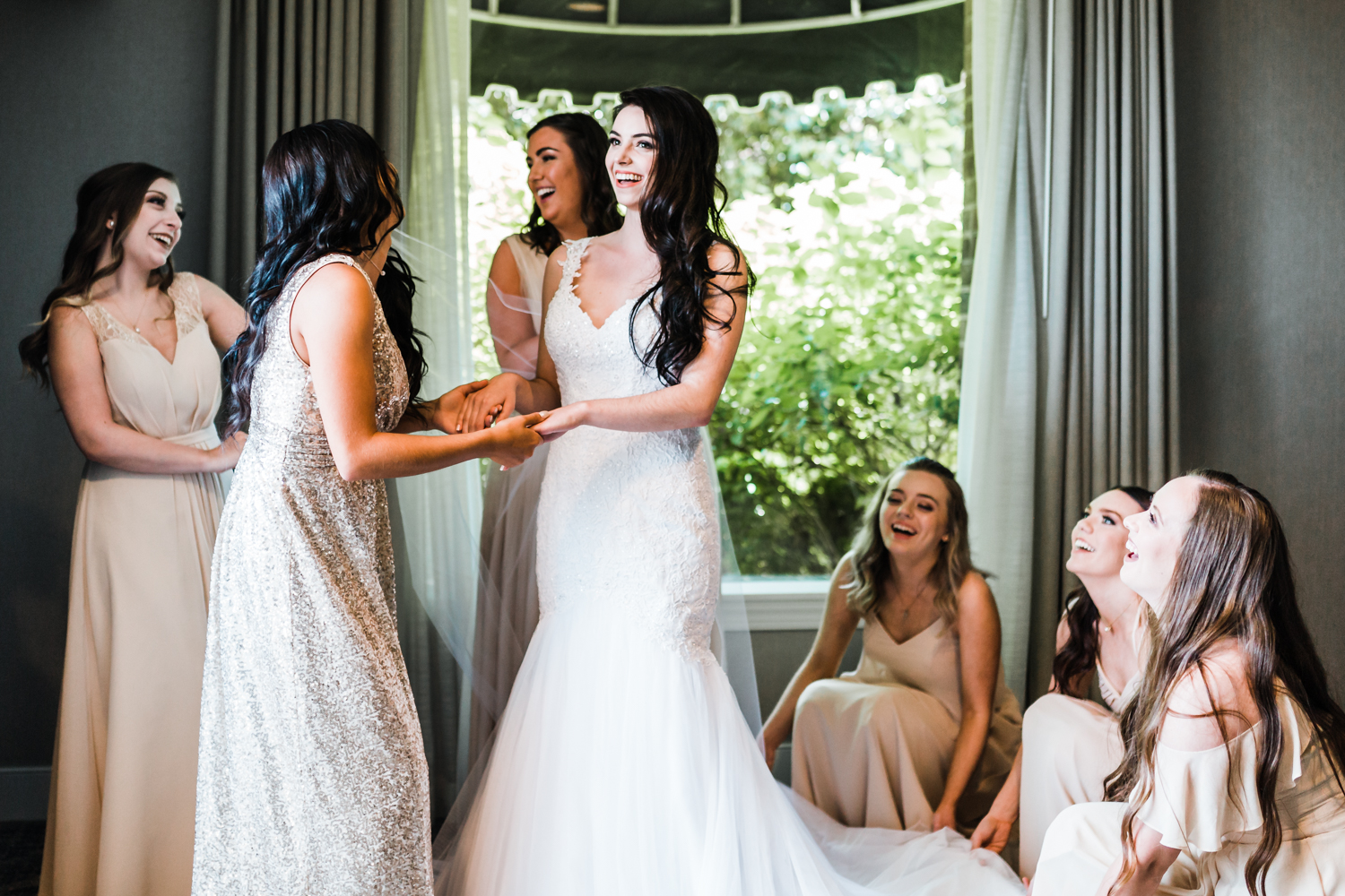 bride laughing with her bridesmaids as they get ready - Annapolis Maryland waterfront wedding veues