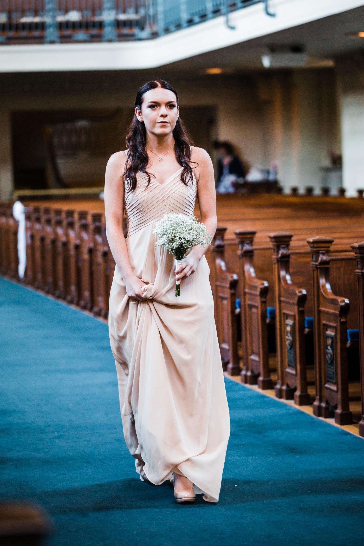 blush and tan wedding color scheme - Naval Academy chapel