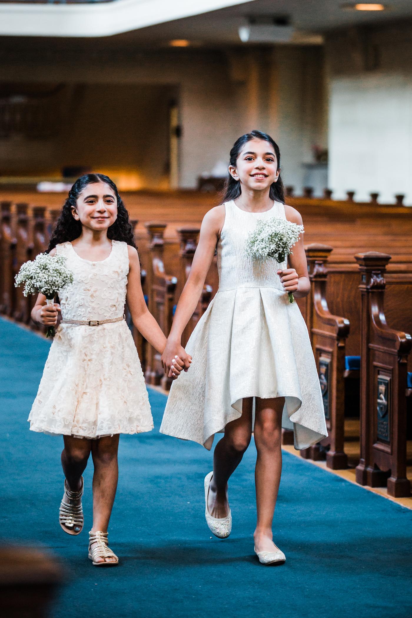 flower girls walking down the aisle - annapolis wedding photographer