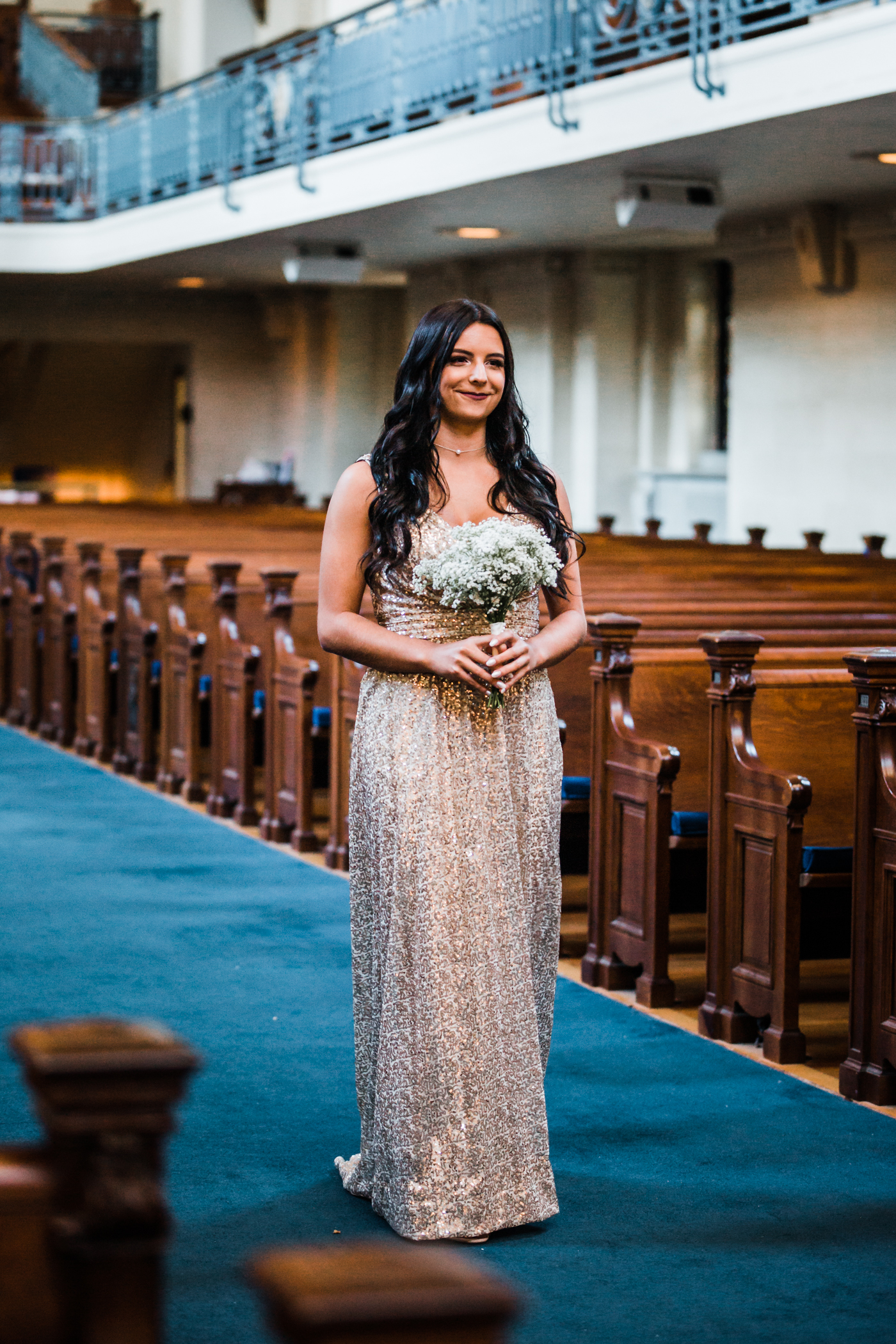 brides sister and MOH walking down the aisle - top rated wedding photographer in Maryland