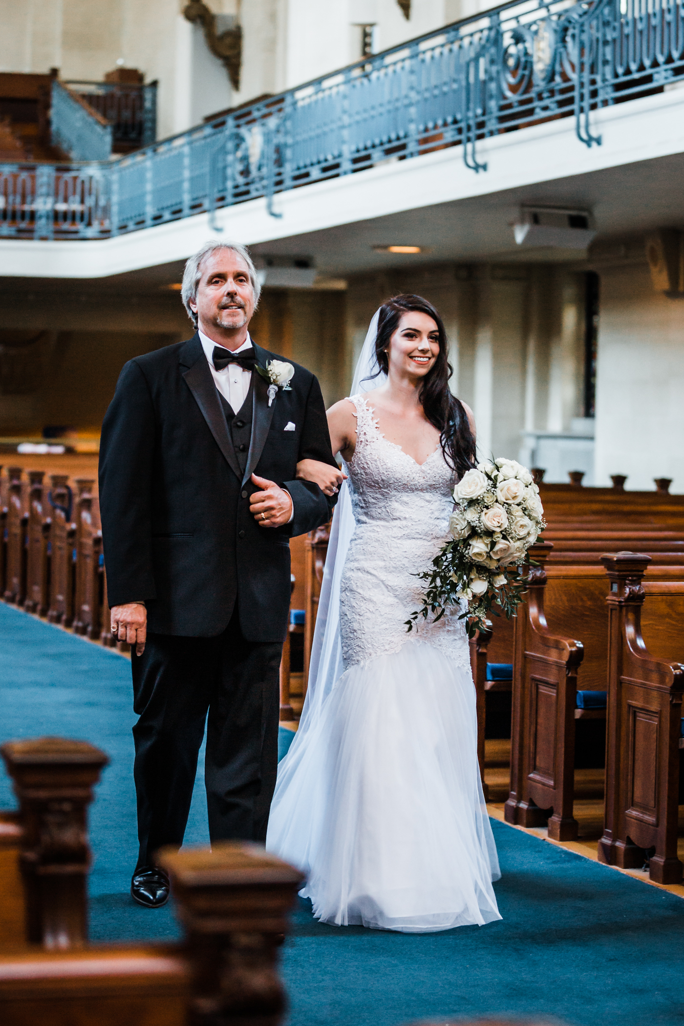 bride walking down the aisle with her father at Naval Academy wedding in Annapolis, MD