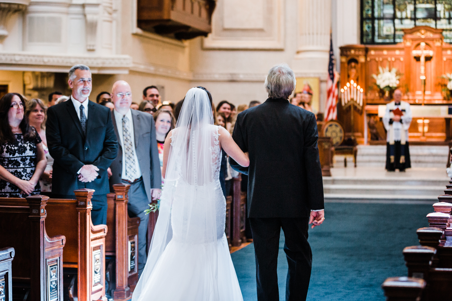 father of the bride walks his daughter down the aisle at her Annapolis, Maryland wedding