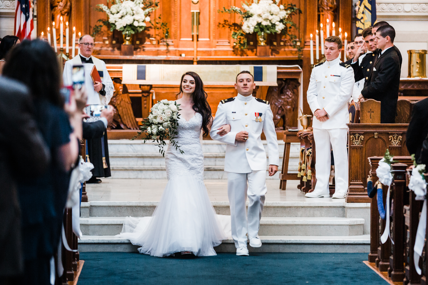 happy bride and groom coming down the aisle after i do