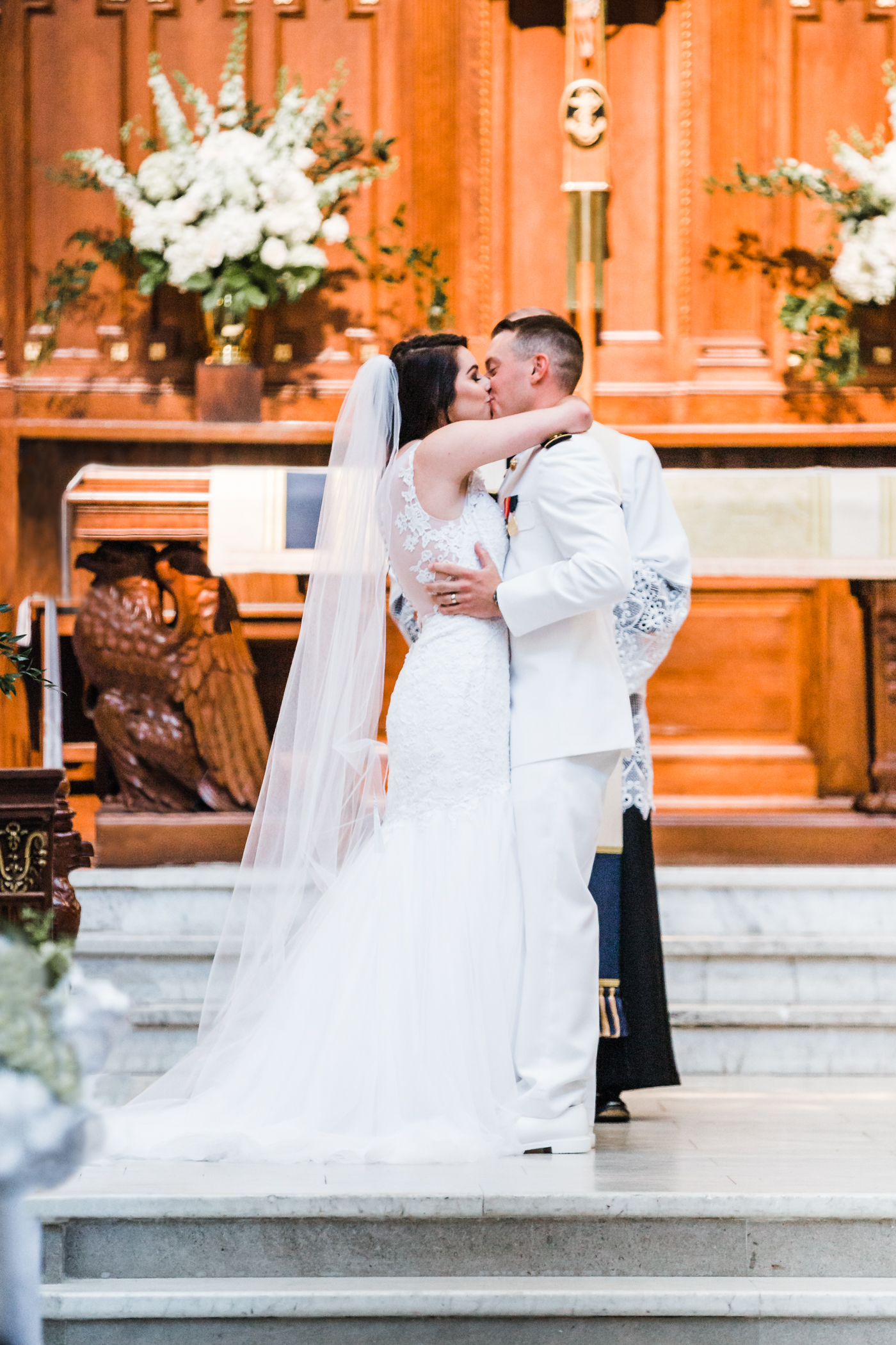 bride and groom share their first kiss - Naval Academy weddings in Annapolis, MD